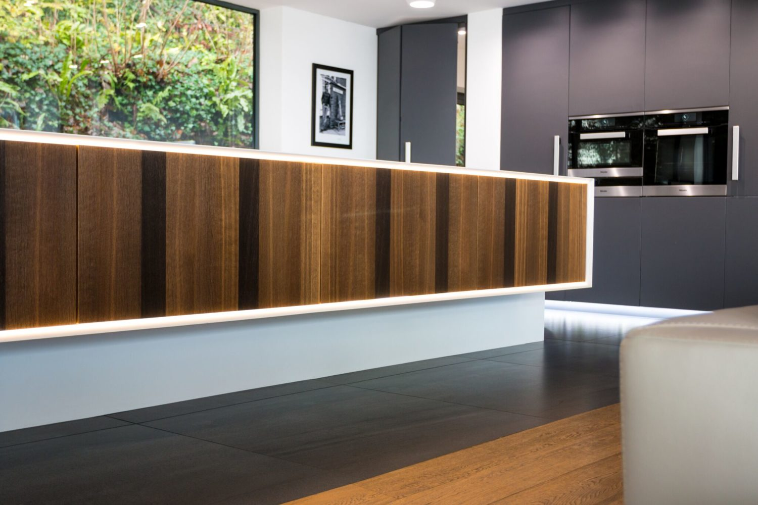 smoked oak and corian island with Miele appliances