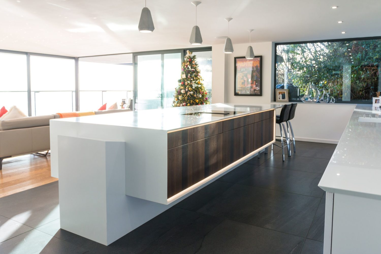 Stunning kitchen island with wrap around corian worktops