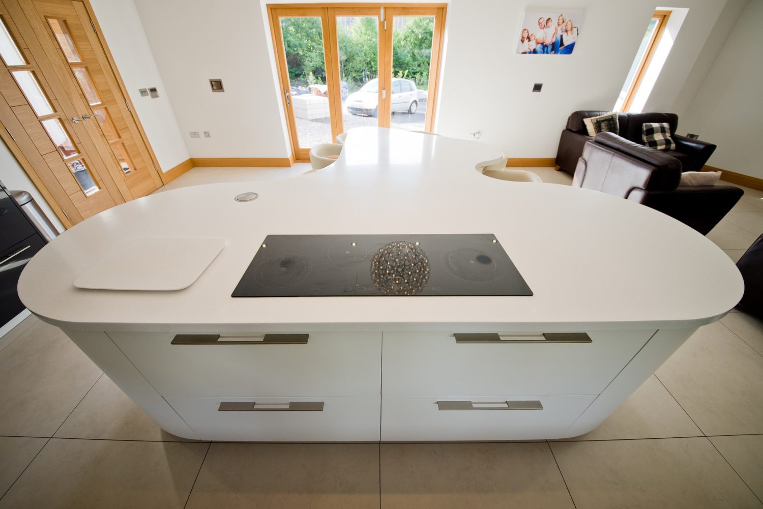 corian curved island with glass induction hob